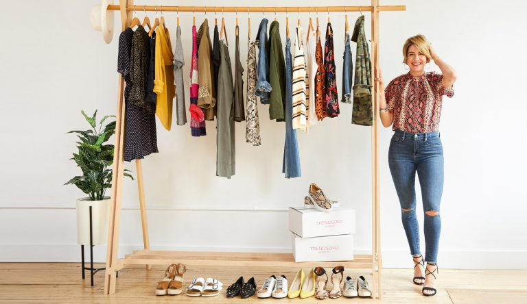 style influencer Beth Chappo standing by a rack of summer clothes
