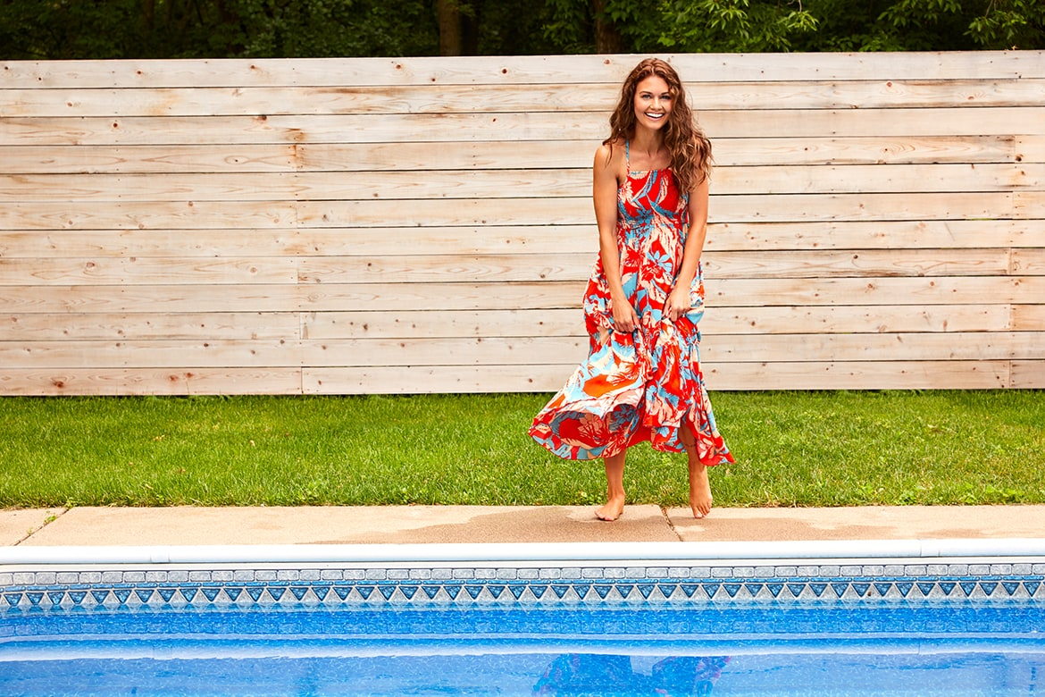 red and blue floral maxi dress by the pool